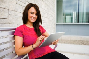 Portrait of young woman holding tablet pc